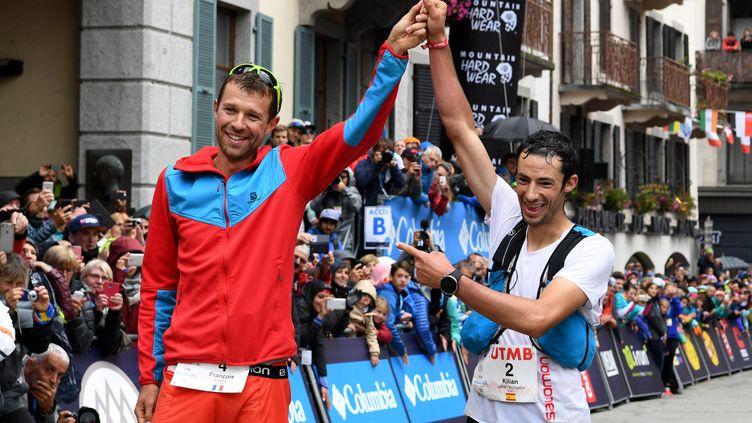 Le vainqueur François d'Haene et son dauphin Kilian Jornet  (JEAN-PIERRE CLATOT / AFP)