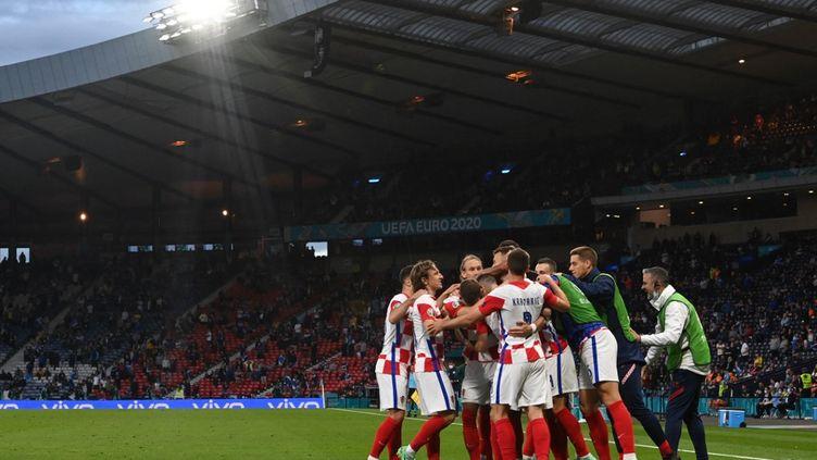 Les Croates célèbrent le troisième but inscrit face à l'Écosse, le 22 juin 2021. (PAUL ELLIS / POOL)