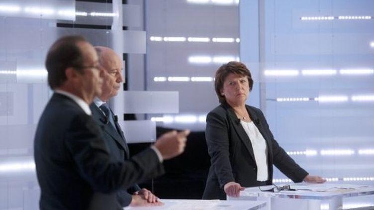 """Martine Aubry et François Hollande sur le plateau de """"Des paroles et des actes"""" de France 2. (AFP - Fred Dufour)"""