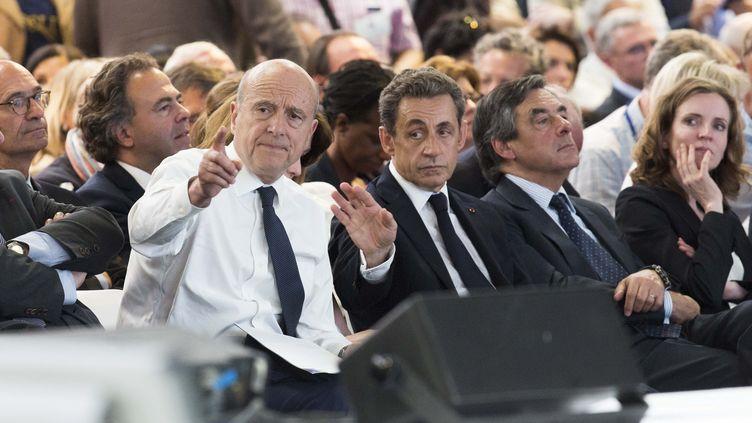 Alain Juppé, Nicolas Sarkozy, Francois Fillon, et Nathalie Kosciusko-Morizet, lors du congrès fondateur des Républicains, à Paris, le 30 mai 2015. (MAXPPP)