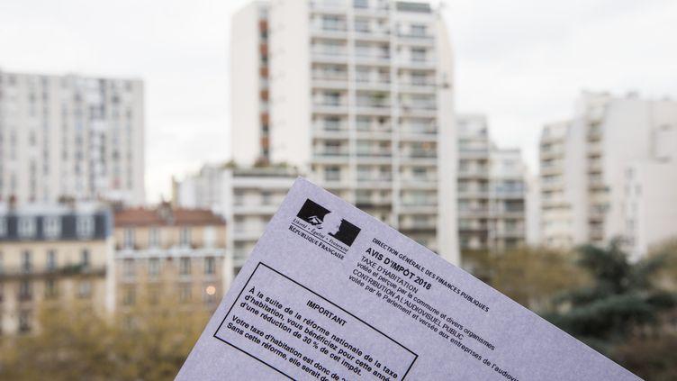 La taxe d'habitation doit être supprimée pour l'intégralité des ménages à l'horizon 2023, mais cette échéance pourrait finalement être différée d'un an ou deux. (RICCARDO MILANI / HANS LUCAS / AFP)