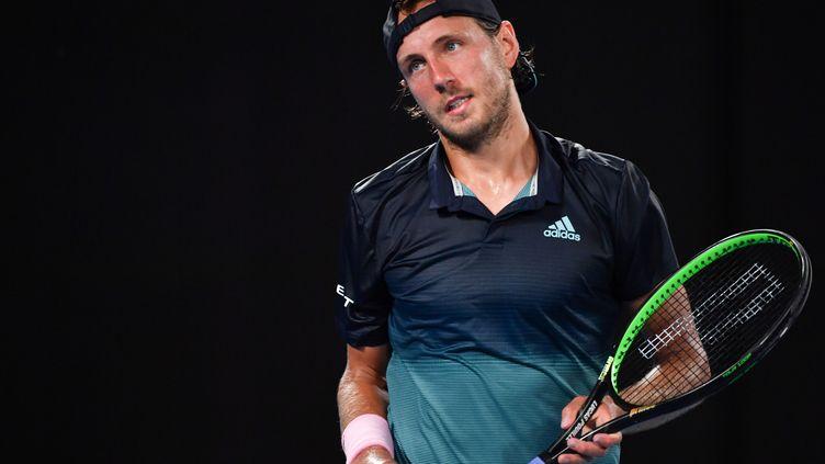 Le Français Lucas Pouille lors de son match face Novak Djokovicen demi-finale de l'Open d'Australie, à Melbourne, le 25 janvier 2019. (PAUL CROCK / AFP)
