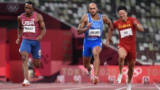 Ronnie Baker, Marcell Jacobs et Bingtian Su ont signé les trois meilleurs temps des demi-finales du 100 m, le 1er août 2021. (JEWEL SAMAD / AFP)