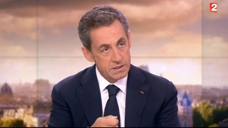 Capture d'écran deNicolas Sarkozy sur le plateau du JT de France 2, le 21 janvier 2015. ( FRANCE 2)