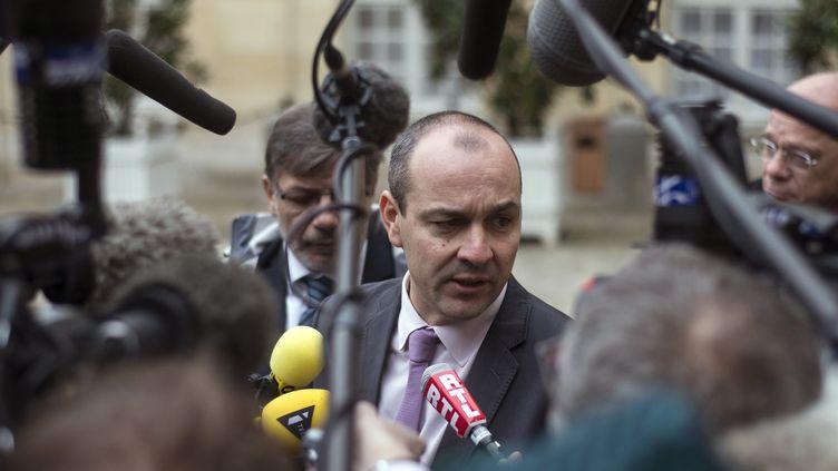 Le numéro un de la CFDT, Laurent Berger, le 25 novembre 2013 à Matignon (Paris) dans le cadre des consultations sur la réforme fiscale. (FRED DUFOUR / AFP)