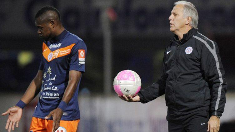 Le défenseur Henri Bedimo et son entraîneur René Girard