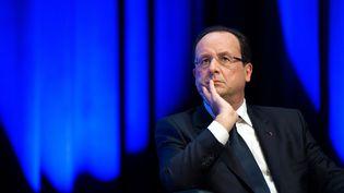 Le président de la République, François Hollande, lors d'un déplacement à Cournon-d'Auvergne (Puy-de-Dôme), le 2 octobre 2013. (LCHAM / SIPA)
