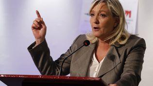 La présidente du FN, Marine Le Pen, lors d'un discours à Paris le 23 juin 2015. (FRANCOIS GUILLOT / AFP)