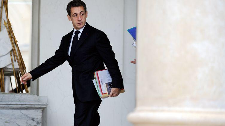 Le président de la République, Nicolas Sarkozy, à la sortie du Conseil des ministres, à Paris, le 7 décembre 2011. (ERIC FEFERBERG / AFP)