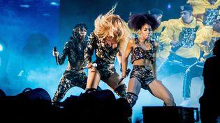 """Beyoncé avec ses """"soeurs"""" de Destiny's Child, Kelly Rowland et Michelle Williams, au festival de Coachella, le 14 avril 2018  (Kyle Grillot / AFP)"""