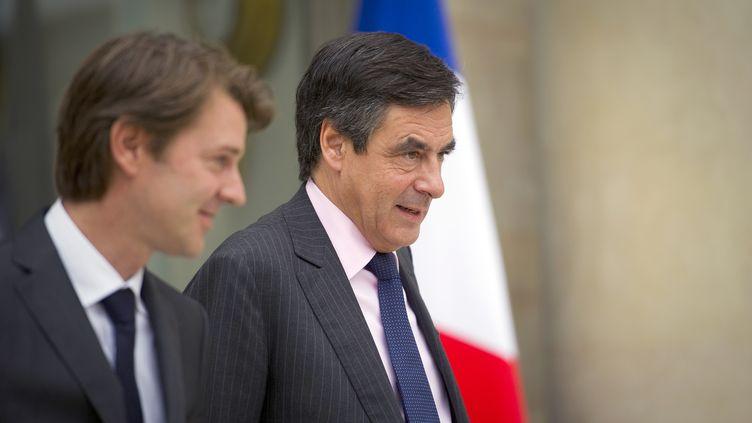 François Baroin et François Fillon à la sortie d'une réunion à l'Elysée, le 5 octobre 2011. (LIONEL BONAVENTURE / AFP)
