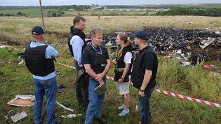 Des experts de l'OSCE attendent de pouvoir inspecter des débris du crash du vol MH17 de la Malaysia Airlines. (DOMINIQUE FAGET / AFP)