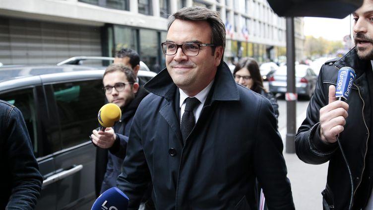 Thomas Thévenoud à la sortie de la commission conjointe des finances et du développement durable de l'Assemblée nationale, à Paris,le 18 novembre 2014. (  MAXPPP)