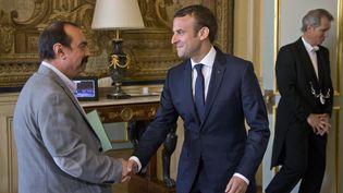 Philippe Martinez (à gauche) etEmmanuel Macron à l'Elysée, le 23 mai 2017. (MICHEL EULER / POOL / AFP)