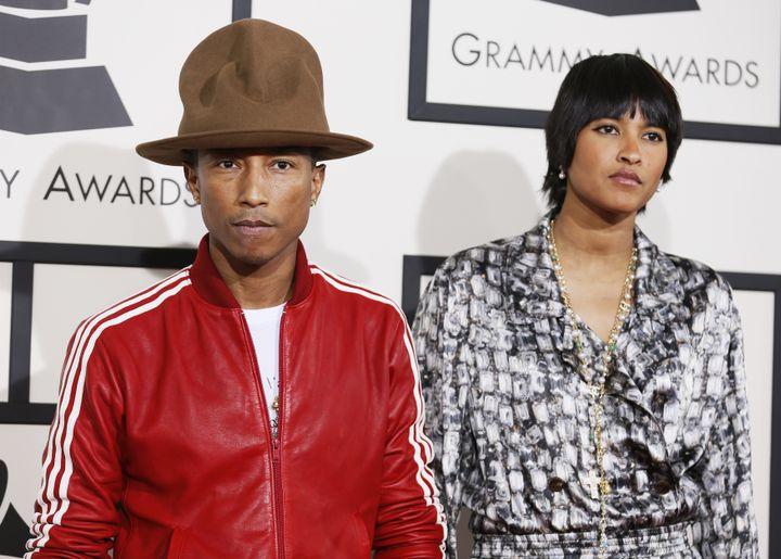 Pharrell Williams et sa femme arrivent aux 56es Grammy Awards à Los Angeles (Etats-Unis), le 26 janvier 2014. (DANNY MOLOSHOK / REUTERS)