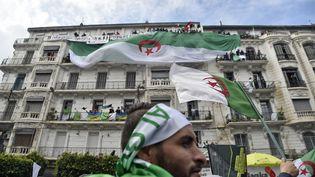 Manifestation contre le candidature à un 5e mandat et le maintien au pouvoir d'Abdelaziz Bouteflika, le 22 mars 2019 (RYAD KRAMDI / AFP)