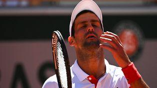 Novak Djokovic à Roland-Garros le 13 juin 2021. (ANNE-CHRISTINE POUJOULAT / AFP)