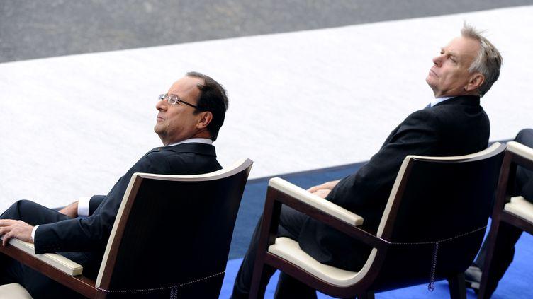 Le président François Hollande et le Premier ministre Jean-Marc Ayrault, le 14 juillet 2012 à Paris. (BERTRAND GUAY / AFP)