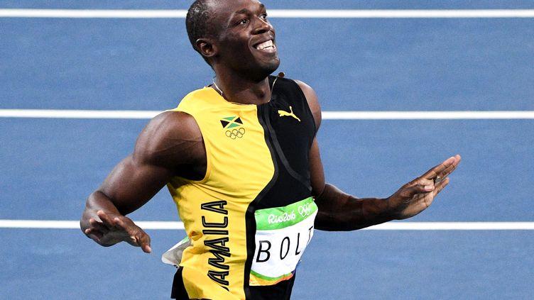 Usain Bolt remporte sa 3ème médaille d'or olympique sur 100m.  (KONSTANTIN CHALABOV / SPUTNIK)