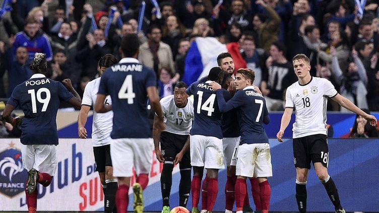 Olivier Giroud buteur avec la France contre l'Allemagne (FRANCK FIFE / AFP)