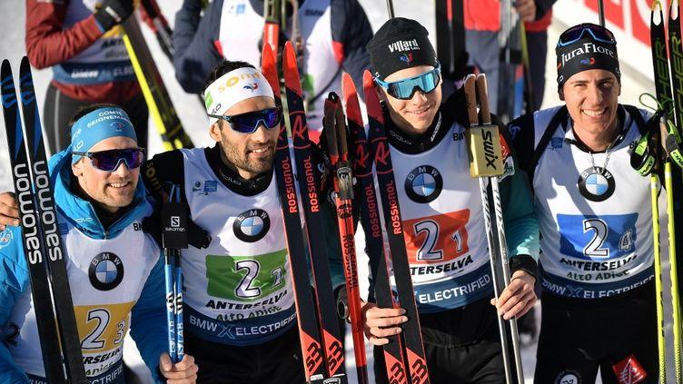 Simon Desthieux, Martin Fourcade, Emilien Jacquelin and Quentin Fillon Maillet ont remporté l'épreuve de relais masculin des Mondiaux de biathlon, le 22 février 2020, à Antholz, en Italie. (MARCO BERTORELLO / AFP)