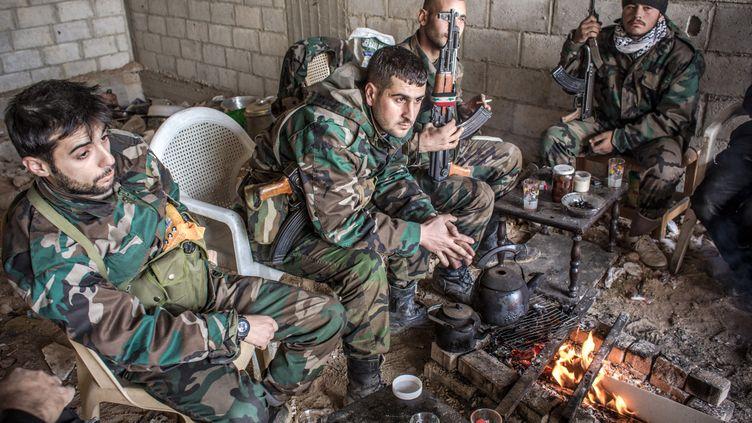 20 janvier 2013 des soldats syriens à Darayya (ANDREY STENIN / RIA NOVOSTI /AFP)