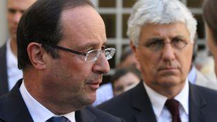François Hollande, accompagné du ministre de l'Ecologie, Philippe Martin, en visite à Valence-sur-Baïse (Gers), le 3 août 2013. (MAXPPP)