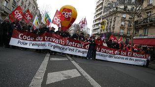 Des manifestants réclament le retrait du projet de la loi El Khomri le 9 mars 2016 à Paris. (THOMAS SAMSON / AFP)