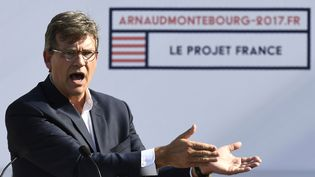 L'ancien ministre de l'EconomieArnaud Montebourg prononce un discours pour annoncersa candidature à la présidentielle de 2017,lors de laréunion annuelle du Parti socialiste, àFrangy-en-Bresse (Saône-et-Loire),le 21 août2016. (PHILIPPE DESMAZES / AFP)