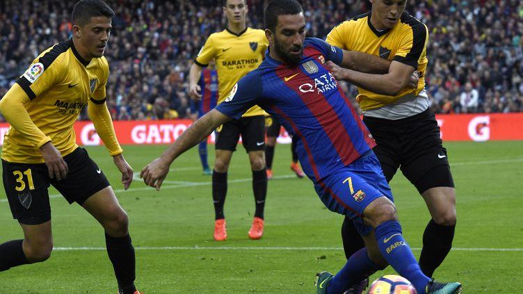 Arda Turan et ses coéquipiers ont buté contre Malaga (LLUIS GENE / AFP)
