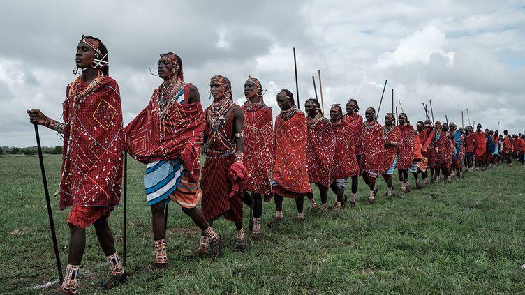 Les Massaï se rendent sur les lieux des compétitions sportives. (YASUYOSHI CHIBA / AFP)