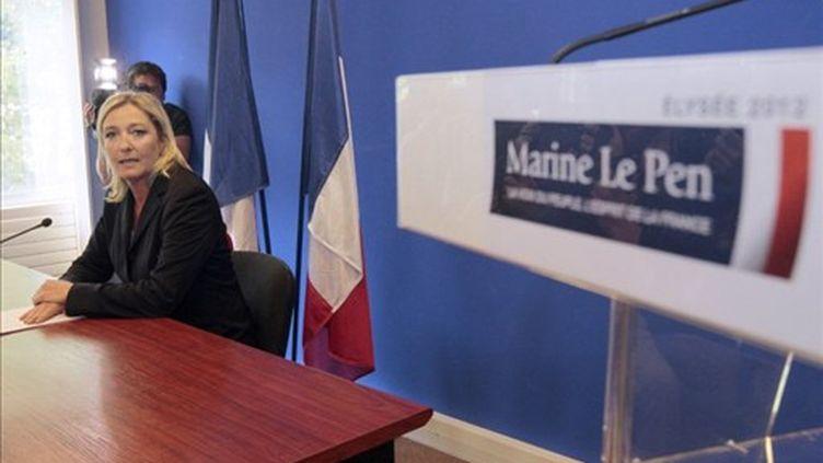 """Marine Le Pen ne se voit pas comme """"la candidate du FN"""", mais comme une candidate """"soutenue par le Front National"""". (JACQUES DEMARTHON / AFP)"""