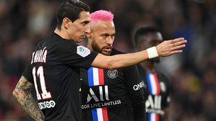 Les Parisiens Angel di Maria et Neymar lors d'un match contre Montpellier, le 1er février au Parc des Princes. (MARTIN BUREAU / AFP)