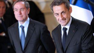 Claude Guéant et Nicolas Sarkozy, le 13 avril 2012 à Ajaccio (Corse-du-Sud). (PASCAL POCHARD CASABIANCA / AFP)