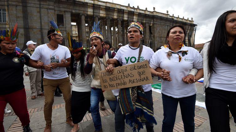 Des indigènes participent à une marche contre le gouvernement du président colombien Ivan Duque, à Bogota, le 27 novembre 2019.  (JUAN BARRETO / AFP)