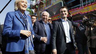 La présidente du FN, Marine Le Pen, et le vice-président du FN, Florian Philippot, à la Foire du Trône, le 7 avril 2017. (PATRICK KOVARIK / AFP)