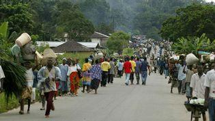 Réfugiés fuyant des combats au Liberia le 5 septembre 2003. (PIUS UTOMI EKPEI / AFP)