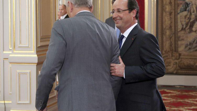 François Hollande et Jean-Marc Ayrault à l'Elysee le 16 mai 2013 (CHRISTOPHE ENA / AFP)