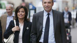 Le député Jean-François Copé et sa femme Nadia arrivent au QG de l'UMP lors du second tour des élections municipales, le 30 mars 2014. (PATRICK KOVARIK / AFP)
