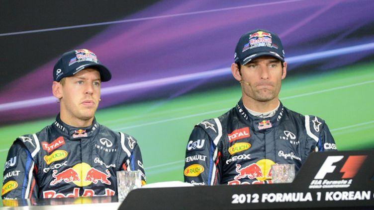 Sebastian Vettel et Mark Webber (Red Bull) (ROSLAN RAHMAN / AFP)