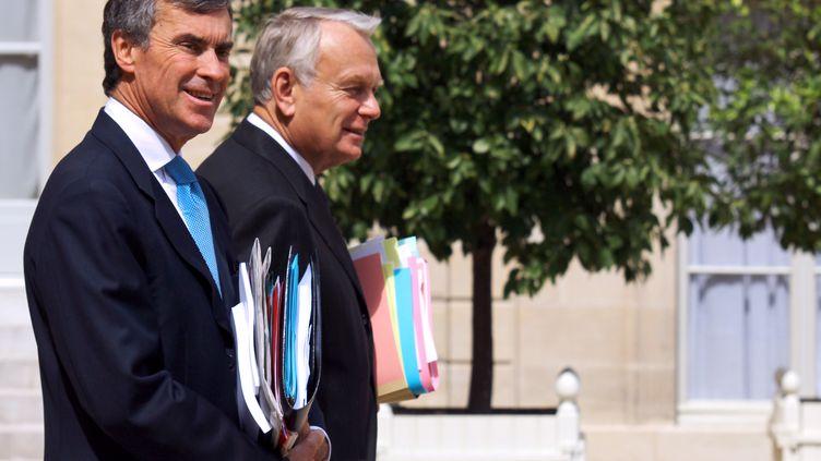 Le ministre du Budget, Jérôme Cahuzac, au côté du Premier ministre, Jean-Marc Ayrault, en juillet 2012 à l'Elysée. (MARION BERARD / AFP)