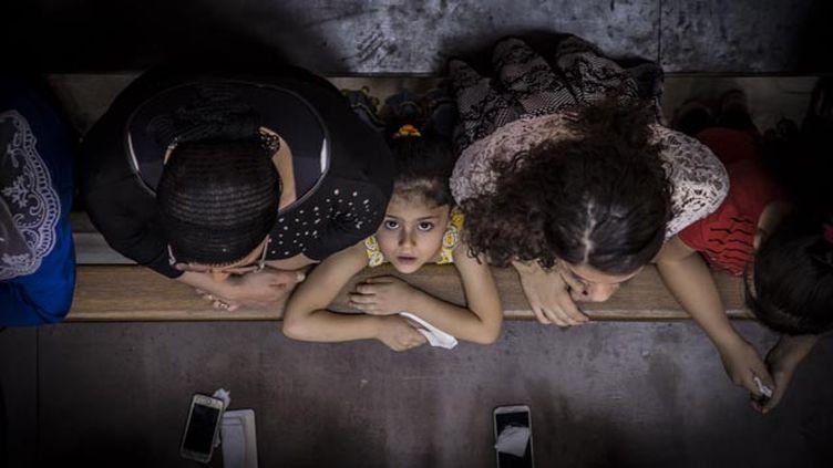 """(""""C'est la première fois que l'Etat islamique s'en prend de cette sorte à des familles chrétiennes d'une part, mais surtout, c'est une cran plus loin dans l'horreur"""", explique Faraj Benoit Camurat © LE CAER VIANNEY/SIPA)"""