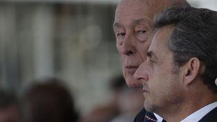 Nicolas Sarkozy assiste aux cérémonies du Débarquement, le 6 juin 2014. (CHRISTIAN HARTMANN / REUTERS)