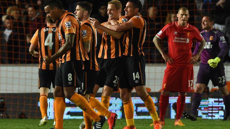Michael Dawson et les joueurs de Hull City (PAUL ELLIS / AFP)