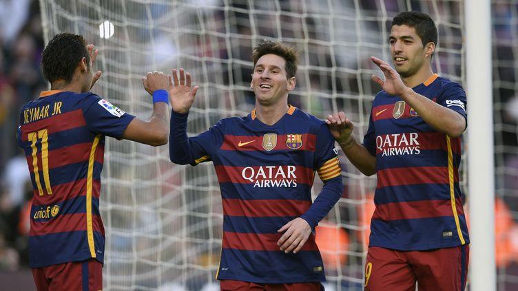 """La joie du trio """"magique"""" du Barça: Neymar, Messi et Suarez (LLUIS GENE / AFP)"""