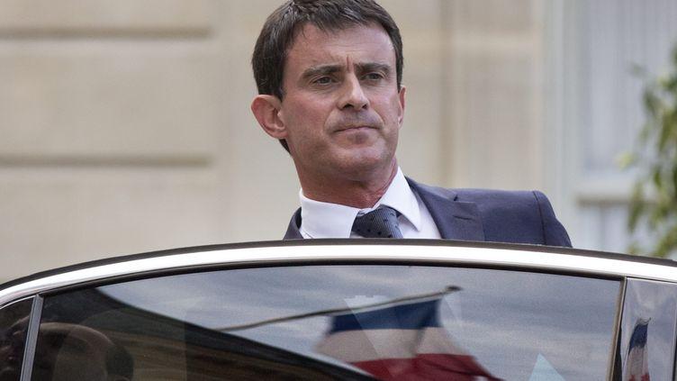 Le Premier ministre, Manuel Valls, à la sortie de l'Elysée, le 24 juillet 2014. (ETIENNE LAURENT / MAXPPP)