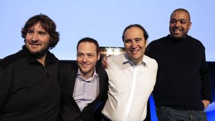 De gauche à droite, Nicolas Sadirac, Florian Bucher, Xavier Niel et Kwame Yamgnane, respectivement directeur général, directeur général adjoint, fondateur et directeur général adjoint de 42, le 26 mars 2013 lors de la conférence de presse de lancement de l'école, à Paris. ( JACKY NAEGELEN / REUTERS)