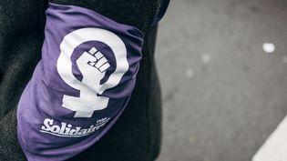 Une manifestante à Paris, le 8 mars 2020. (DENIS MEYER / HANS LUCAS / AFP)