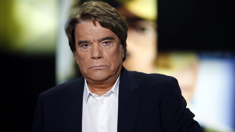 Bernard Tapie sur i-Télé, mercredi 10 juillet 2013. (FRED DUFOUR / AFP)