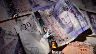 La livre sterling est tombé àson niveau le plus faible en près de sept ans face au dollar. (BEN STANSALL / AFP)